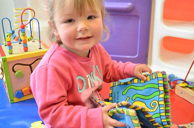 Children reading St Cuthbert's Children's Centre