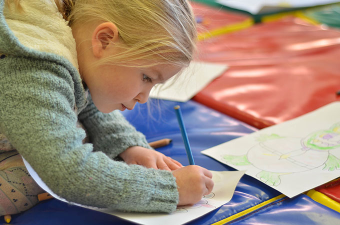 Children colouring at St Cuthbert's Children's Centre